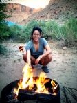 Cooked Paleo food on a stick over a campfire.